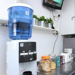 There is a water dispenser. Say No to bottled water!