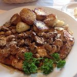 Two large chicken breasts smothered in mushrooms and Marsala wine sauce crowned with roasted pot
