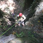 Guest rapelling a dry waterfall