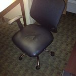 Desk chair missing left arm oversight.