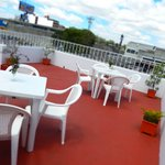 enjoy the sunshine and breeze on the rooftop terrace