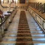 Staircase lined with portraits of famous guests