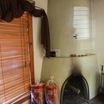 Kiva (fireplace) in living room. They provide firewood for a fee, or you can bring your own.