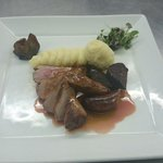 Pan fried duck, wild boar sausage, black pudding with port jus