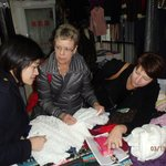 The dressmaker (left) and MJ (right) help Nancy pick out material for a dress that was made in 2