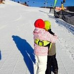 Twins hugging after a day of skiing