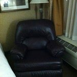 Plush recliner in room.
