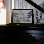 Top of the piano and my pen and ink of the Manse