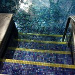 Small pool with iridescent tiles