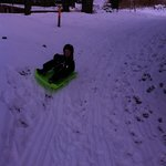 sledding outside our cabin