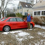 Bill, the innkeeper, with one of his red cars