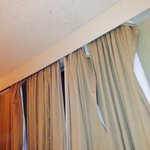These were our curtains straightened out as well as we could and some sort of foreign splatter o