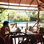Checking email in the poolside dining area