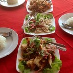 Delicious lunch of deep fried garlic prawns, coconut squid and black pepper crab