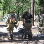 guide and soldier heading to the water on the Animas River