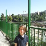 my son outside avissar with old city behind him.