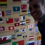Davide Luigi Paolo near the kitchen International flags decorated wall!
