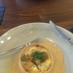 A crab and fennel tart with seafood sauce; opposite haggis fritter, poached egg and a whisky sau
