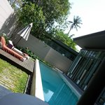 View of the pool and sun loungers from the outdoors seating area ;-)