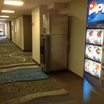 hallway with convenient drink vending machine and ice machine