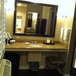 Room 201, large bathroom vanity with toiletries.