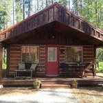 Cabin exterior view with seating porch