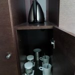 Water cooker with mugs, coffee, cream and sugar