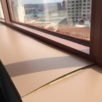 Unrenovated window sill w/warped formica
