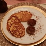 Cornmeal pancakes and sausage breakfast.
