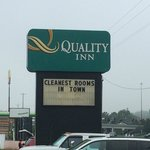 "Sign says ""cleanest rooms in town"". I find that hard to believe."