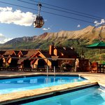 Outdoor heated pool and hot tub with gondola in background
