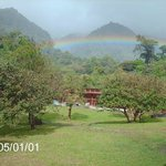 Rainbow over Ecolodge. Monteverde in background
