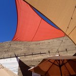 Lovely sail-like shade covers on the patio.