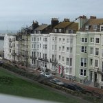 View of the English Channel, Brighton Pier and Brighton Wheel, and with New Steine park below.