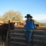My daughter in front of the horse pen
