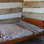 parent's bed in the log cabin