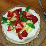 Meringue cake with strawberry and pineapple