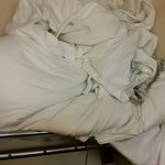Dirty linen that was on the bed when I checked in.