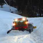 The piste beast grooming slopes at the end of a day