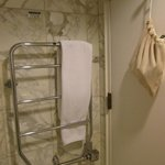 The heated towel rack. Note the bag for the hair dryer hung on the door.