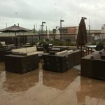 Outdoor seating area on 2nd floor with pool beyond