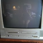 Our TV, 80's model, hole where we had to stick a finger to turn on...really!