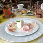Breakfast - Fresh breads, juices, cereals, eggs, mozzarella, prosciutto, lardo, coffee, tea...