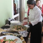 Samia with the buffet lunch she has just demonstrated cooking.