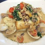 The Special, Halibut Steamers: Steamed clams and clam sauce over pan-fried halibut served on a b