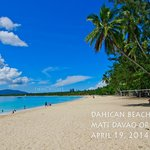 White long beach of Dahican. Clear and blue waters