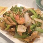 Crispy fried noodles with shrimp, chicken and vegetables in a savory sauce