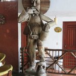Huge carved statue of Pancho Villa in the pool-side bar area