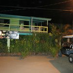 Front night view of Casa Placencia, with our golf cart parked out front.