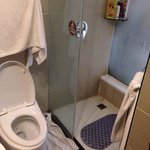 Western toilet, hot water, limited water leakage into rest of bathroom. Plenty of room to move a